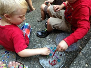 Preschoolers making stepping stones.